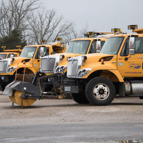 A line of Missouri Department of Transportation trucks parked together