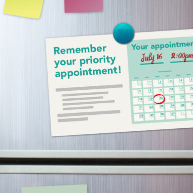 An appointment reminder on a refrigerator door