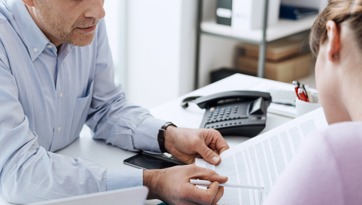 A career counsellor explaining the details of a document to a job seeker