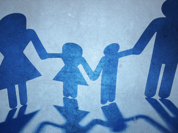 Silhouettes of stick figures holding hands to form a chain