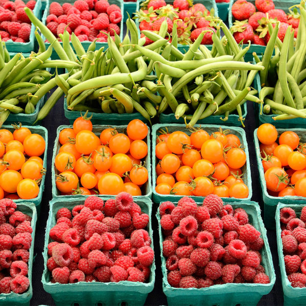 Assorted fruits and vegetables on display in a farmers market
