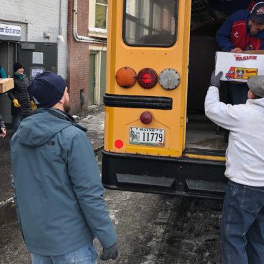 Volunteers unloading groceries for the Preble Street Resource Center