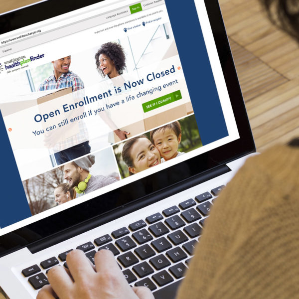 The Washington Health Plan Finder website being viewed on a laptop