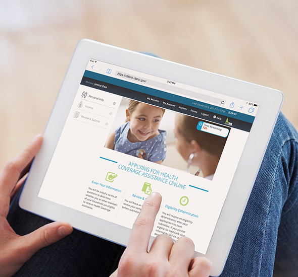 A person viewing the idalink benefits eligibility portal on a tablet