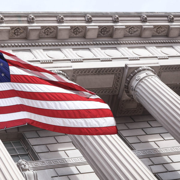 Columns of a courthouse with the US flag